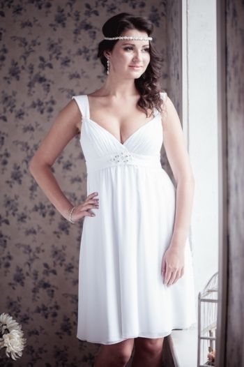Model 17. Empire silhouette short wedding dress - white chiffon; - empire line, molded cups, draped cups, fully lined, crystal Swarovski and bead embellishments at center of tie and at underside of straps; - concealed zip fastening along back; - dry clean