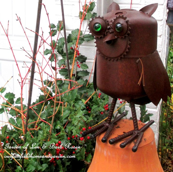 Winter Owl   http://ourfairfieldhomeandgarden.com/rustic-watering-cans-windowboxes-more/