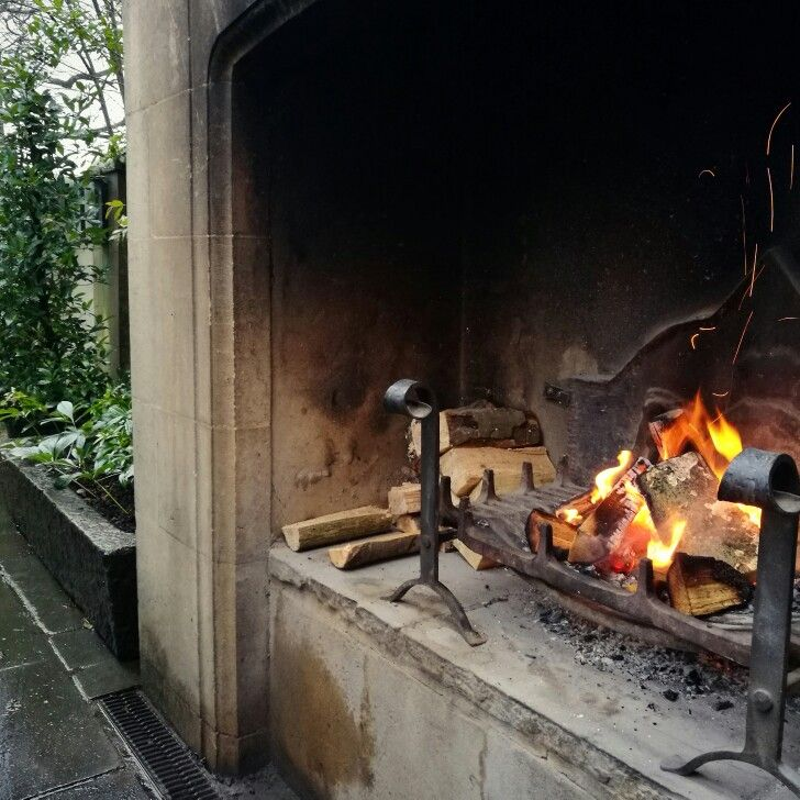 Warm yourself up by the outdoor fire at The Pig, Brockenhurst. #fire #art #design #warm #weather #winter #cold #cosy #hygge #lunch #romantic #memories #flames #architecture #style #building #fireplace #antique #english #beautiful