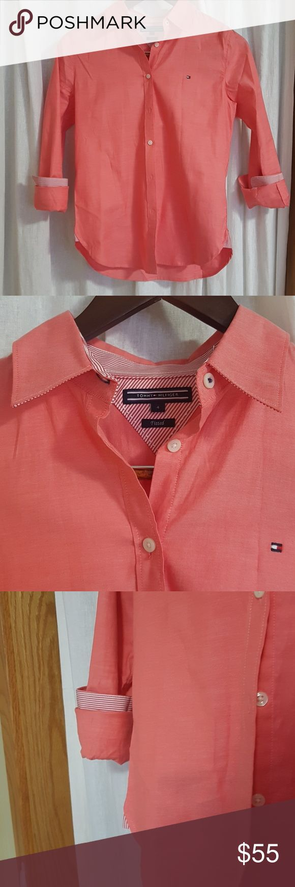 Coral tommy Hilfiger shirt This beautiful Tommy Hilfiger shirt is perfect for warmer weathers. This gorgeous shirt is a must have for a dressy yet cute summer preppy outfit. This shirt was worn once and is in excellent condition. This was purchased at an authentic Tommy Hilfiger store in Korea. Tommy Hilfiger Tops Button Down Shirts
