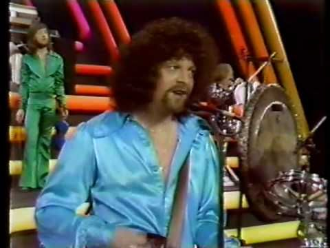 ELO - Livin' Thing (1977) Definitely sounded better played through HI-FI - but the vids worth it just for all the satin . . .and the hair!
