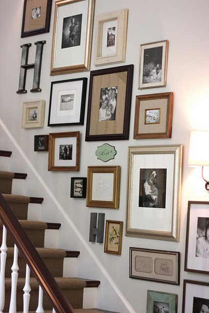 Uses mix of frames: black, wood & light on a white background. Love it- no need to buy all matching frames!
