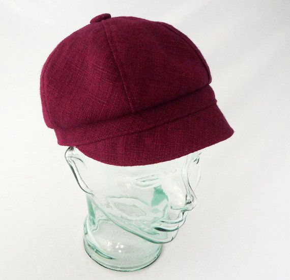 Garnet Red Silk Womens Newsboy Hat  Made from a light weight woven raw silk in a richly colored garnet red, this comfy everyday cap is the perfect three season accessory for running around town or running around the world!  We cut the six panels for this hat asymmetrically to create a soft and flattering beret-like pouf that can be worn to either side, while gently overlapping the 3/4 band. The short, soft, and tidy brim is about 1 3/8 at its deepest in the front and is unstructured...