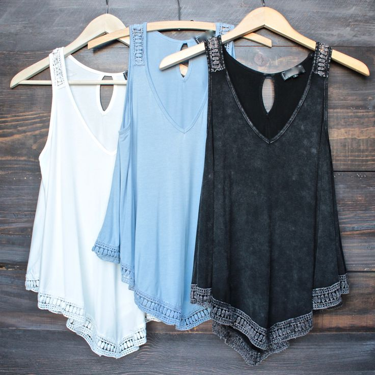 soft & breezy tank top. Black color is topped with an all over acid-wash design. Crochet inset detailing at the straps and hem adds to its urban retro cool factor. Imported. color: black mineral wash,