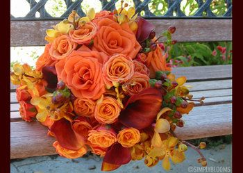 Lovely orange bouquet with accent flowers in yellow/gold and maroon/red<---- I'd like fall colors for my wedding c: