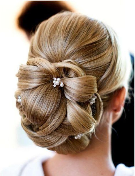 Stunning 1960s inspired up-do hairstyle with beaded accents. Ideal bridal or bridesmaid style!
