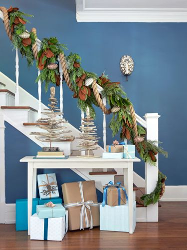 Two-inch-thick hemp rope with mercury glass clamshell ornaments give a classic garland a nautical look.