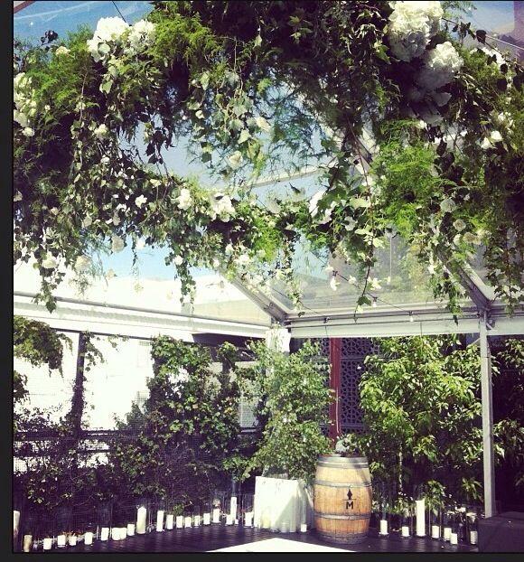 Square floral chandelier by flower jar