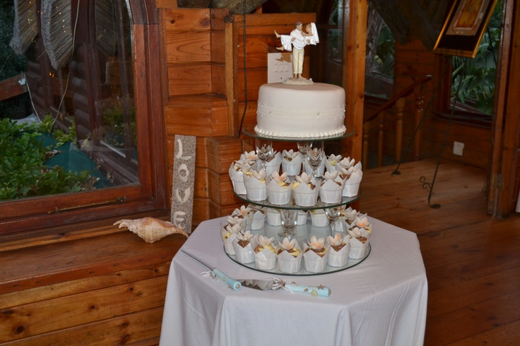 Wedding cake with cake topper and cup cakes for all (chocolate and vanilla cupcakes)