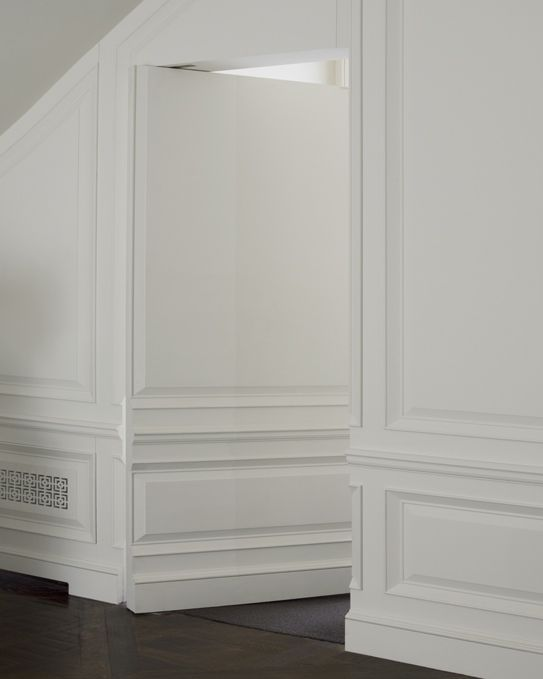 Love the hidden door into another room. The door molding matches the wall trim perfectly. Very clever !