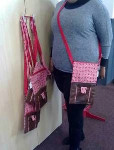 fabric mixed with leather shoulderbags.