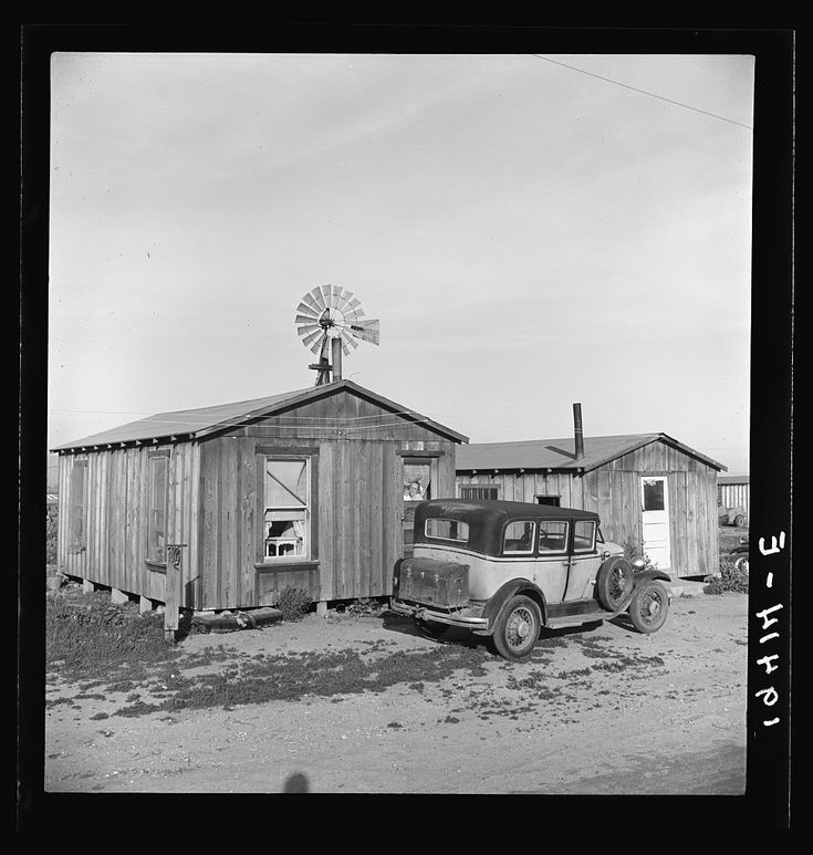 Cabins which rent for ten dollars a month. Includes iron bed and electric lights. In Arkansawyers auto camp. Greenfield, Salinas Valley, California Photographer Dorothea Lange Created April 1939 Location Greenfield, Monterey, California Photogrammar