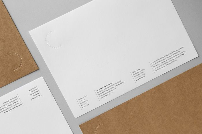 """Identity for Carolina Manresa, a doctor and professor of dentistry at the University of Barcelona. The fifteen pieces that make up her name combine to """"bite"""" a logotype in the shape of a letter """"C,"""" recalling the characteristic plaster moulds."""