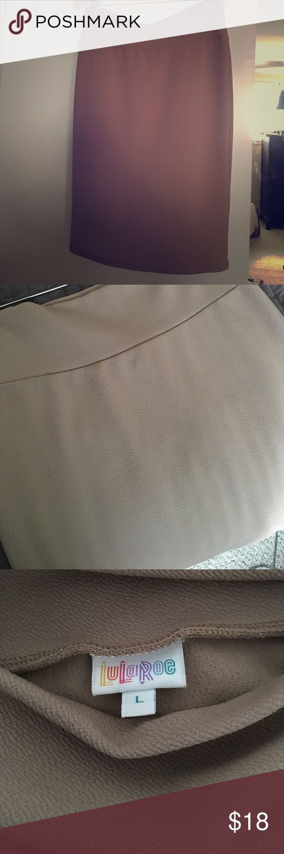 """Khaki pencil skirt LLR *never worn This LuLaRoe khaki pencil is wonderful as I love how light weight it is.  It didn't work with what I bought it for and I washed it in cold water and hung it dry thinking I would wear it and I never have, so it's practically brand new!!!!   Ribs slim through hips and hits just below the knee (5'4"""" tall). LuLaRoe Skirts Pencil"""