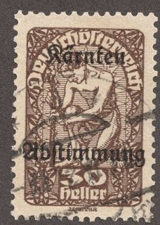 """1920 Austrian Carinthia Plebiscite Semi-Postal Scott B16 30h brown on buff overprinted """"Karnten Abstimmung"""" Big Blue Picture The '47 and '41 editions, under """"Carinthia"""", have a half page of Carinthian Plebiscite stamps from both Austria and Yugoslavia. This entry disappeared with the '69 and '97 editions. So the stamps are all gone from Big Blue also, right?"""