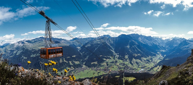 Into the clouds we rise on to the summit of mountains surrounding Davos. Skip the uphill climb and talk a walk along paths giving your spectacular views. #CWAdventure #Family #FamilyTravel #Switzerland #Davos #Europe #Mountains #CableCar #Children