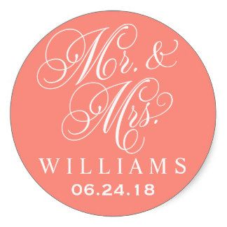 """Wedding favor sticker design features """"Mr. & Mrs."""" in a white calligraphy script font with custom monogram design that can be personalized with the bride and groom's married name and wedding date.  Coral background color can be customized."""