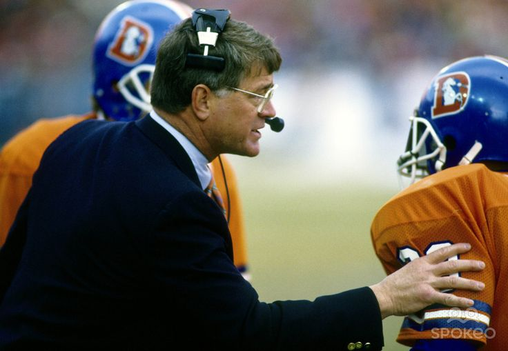 Denver Broncos head football coach Dan Reeves, coaching the Broncos during a game in the mid 1980's