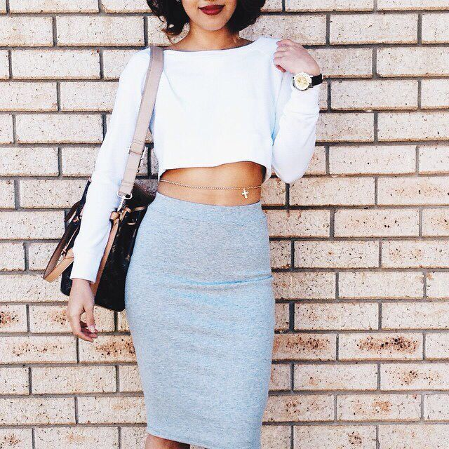 Crop top with grey fitted skirt and cross belly chain