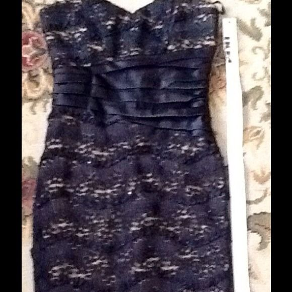 """Beautiful black over nude cocktail dress. Gorgeous sexy, black lace, over nude bandaid style cocktail dress. From shoulder to hem about 37"""" I. Length mystic Dresses"""