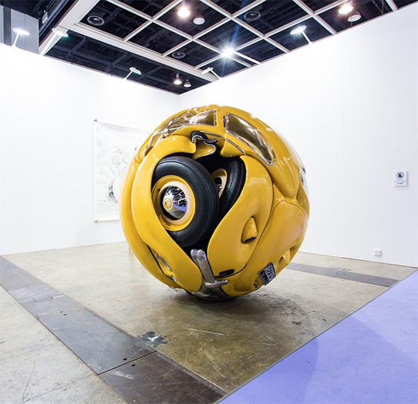 Real Volkswagen Beetle Curled Up Into a Perfect Sphere   Walyou