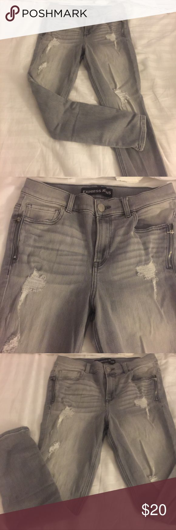 Gray Express size 8Short jeans Washed out gray denim stretch skinny jeans. Super cute! High waisted featuring two zipper pockets. These are size 8 SHORT! They have great stretch to them and are super comfy! Only worn maybe 3x! Awesome condition just a little wrinkled 😉 but no stains or tears(that aren't supposed to be there haha) Express Jeans Skinny