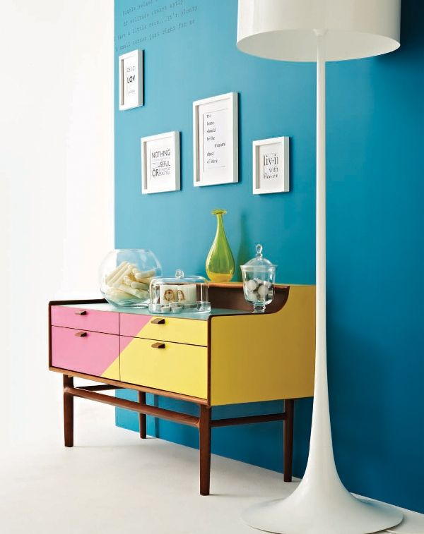 The colour choice and design on this mid-century style sideboard is a great upcycle inspiration. The candy colours contrast with the teal wall and with the white statement lamp and picture frames, the look is very on-trend for 2014.