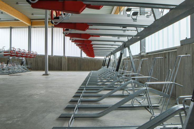 Aluminum bike racks and wooden structure inside Various Architects´ Norwegian bicycle hotel. /  Aluminium sykkelstativ og trekonstruksjon i Various Architects 'norske sykkelhotell.