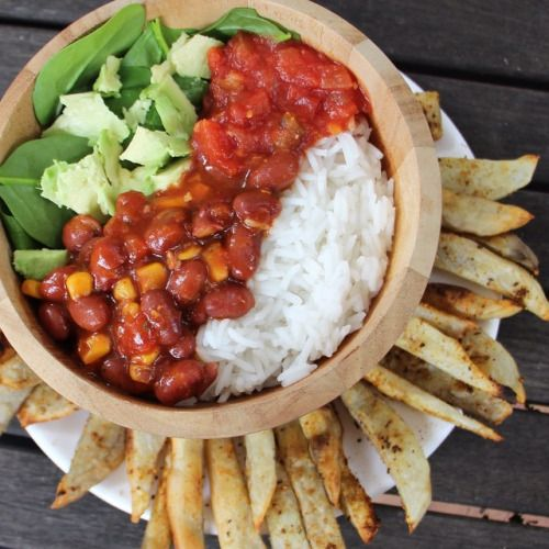 rawrhirhi:  Carbing up Rice, beans, spinach, avo, salsa and baked chips The bowl is bigger than it looks, so full right now