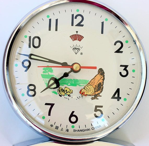 Vintage alarm clock with animated chicken Wind up mechanical