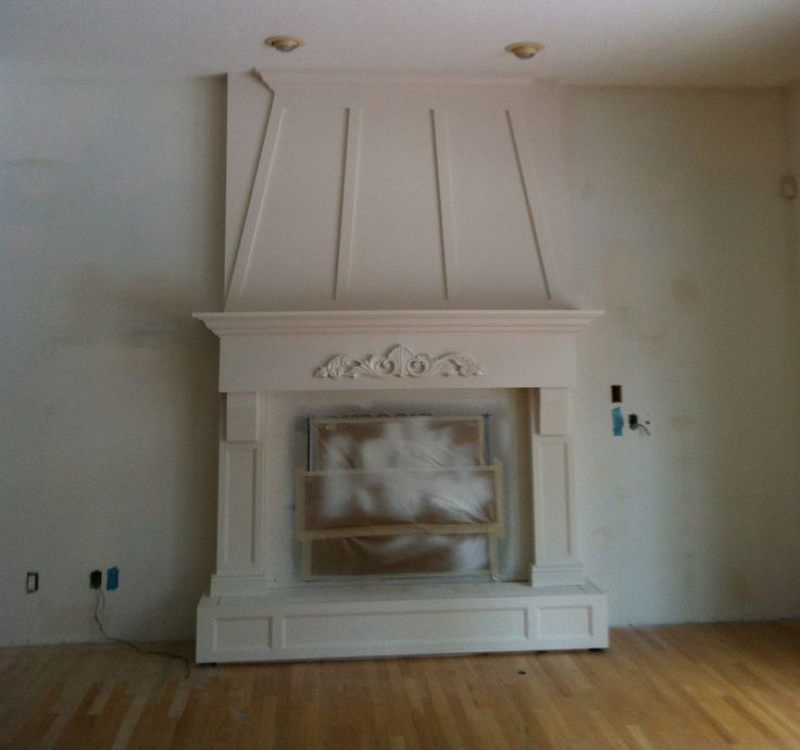 custom English style Rumford fireplace getting sprayed out