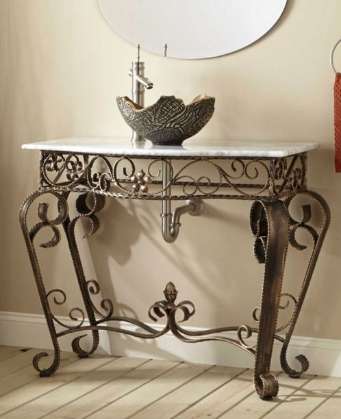 Beautiful curves adorn this classic wrought iron stand console vanity the signature bathroom for Wrought iron bathroom furniture