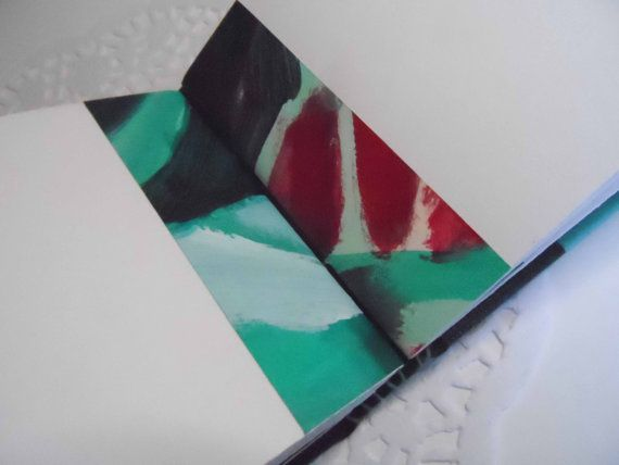 Hand bound green sketchbook with cutaway by JaninaMaherArtist