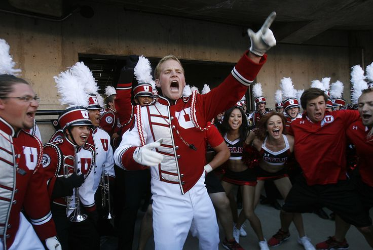 (Scott Sommerdorf   |  The Salt Lake Tribune)  Utah drum major Cheston Newhall gets the band fired up 25 minutes prior to gametime. Later Utah took a quick 7-0 lead over USU early in the 1st period, Thursday, August 29, 2013.