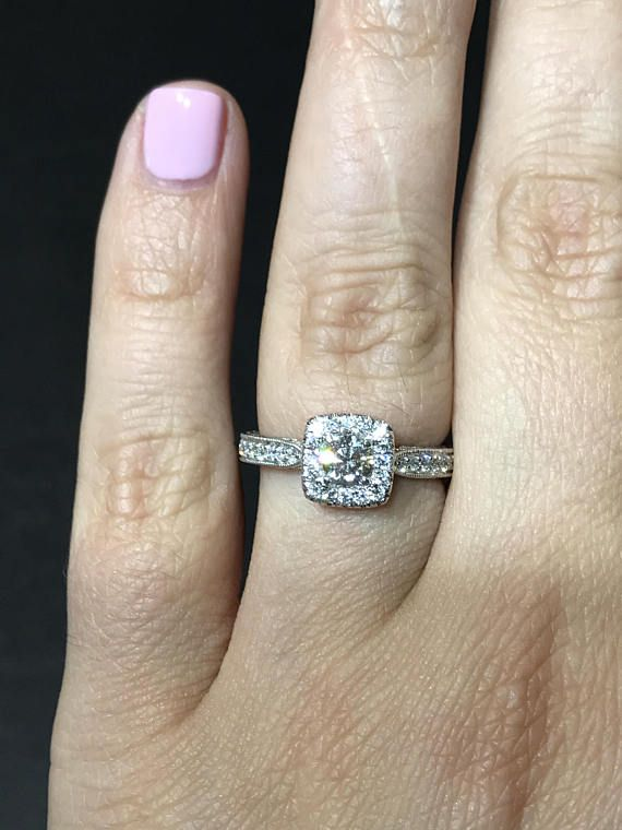 Hand engraved engagement ring with round center stone (00620
