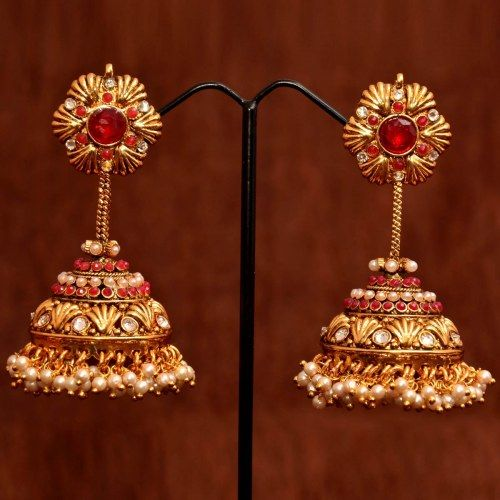Anvi's designer bridal jhumkas with pearls and rubies