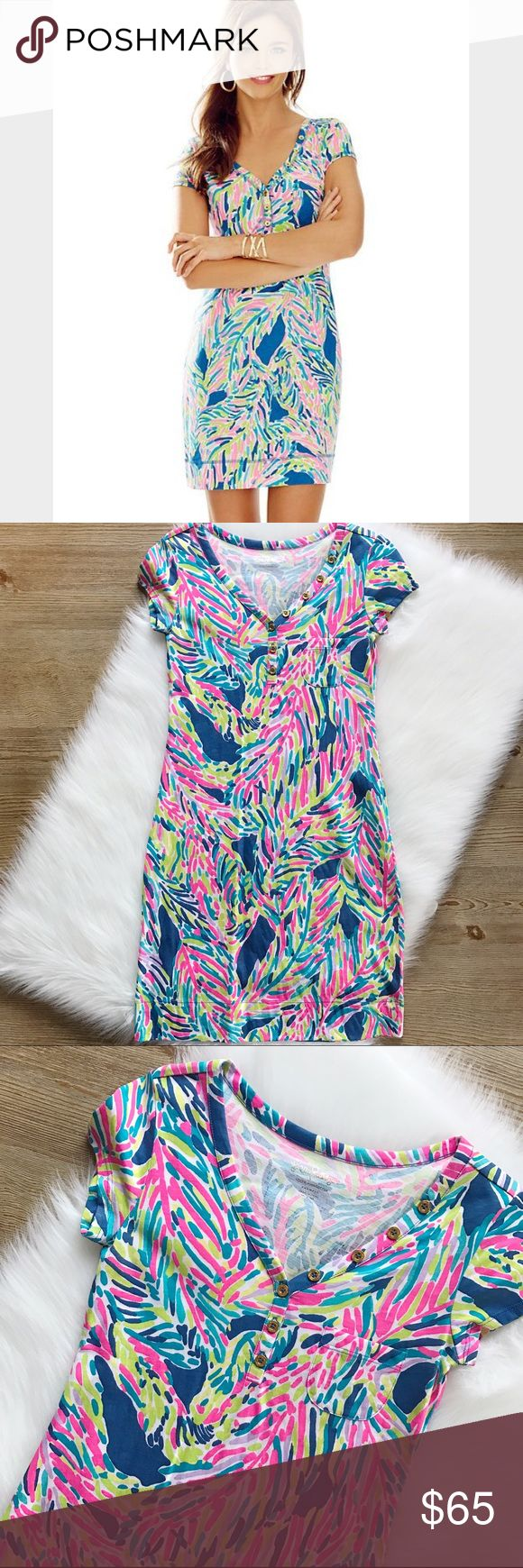 SALELilly Pulitzer Palmira V-neck Dress Absolutely gorgeous dress, size is XXS, v-neck, decorative buttons, fits tts, wore it 2 times maybe, washed and hung to dry, 100% cotton, made in Peru.           10% off bundle of 2 items or more!                             •NO TRADING                             •reasonable offers                             •smoke free Lilly Pulitzer Dresses