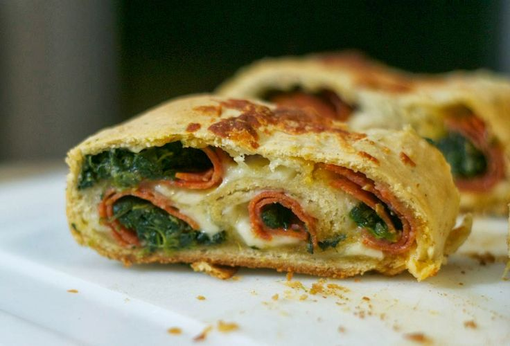 This Spinach Pepperoni Bread - pizza dough filled with spinach, pepperoni and provolone. It makes a great dinner or the perfect finger food for Game Day!