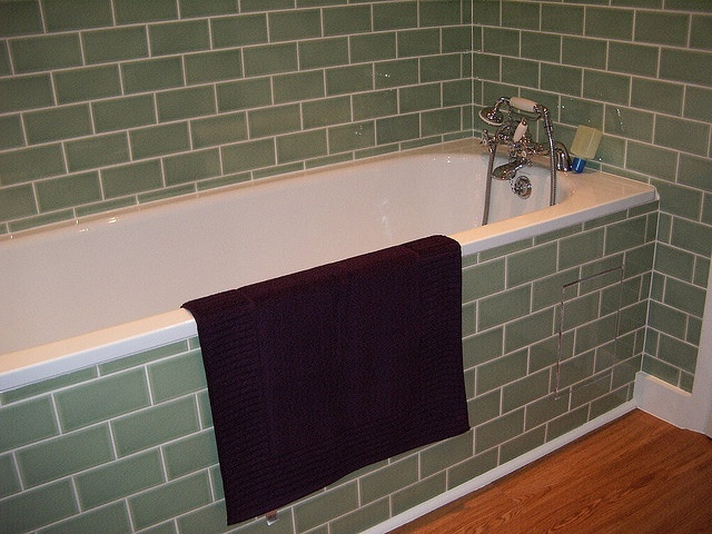 Tiled bath panel by Batmo, via Flickr