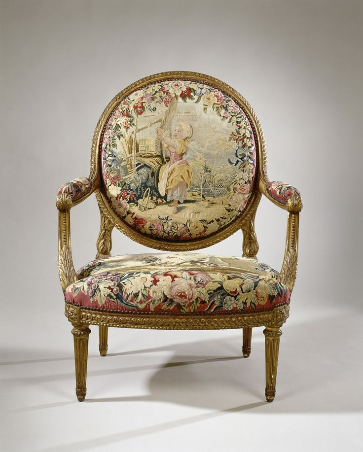 Armchair in tapestry with a girl with birdcage and the fable of the Cock and the Pearl (seat) by manufacture Royale des Gobelins, c.1755-c.1765. Rijksmuseum, Public Domain