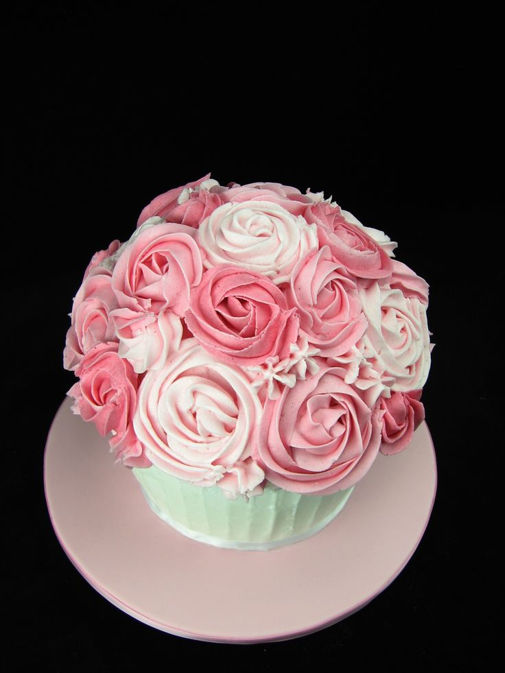 This giant cupcake is vanilla cake with buttercream. It will be used in a smash cake photoshoot.