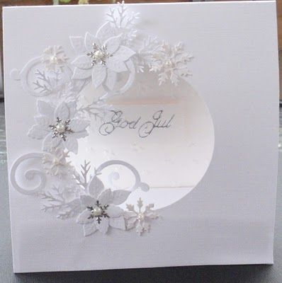white on white circle cut out embellished with punched flowers. stunning.
