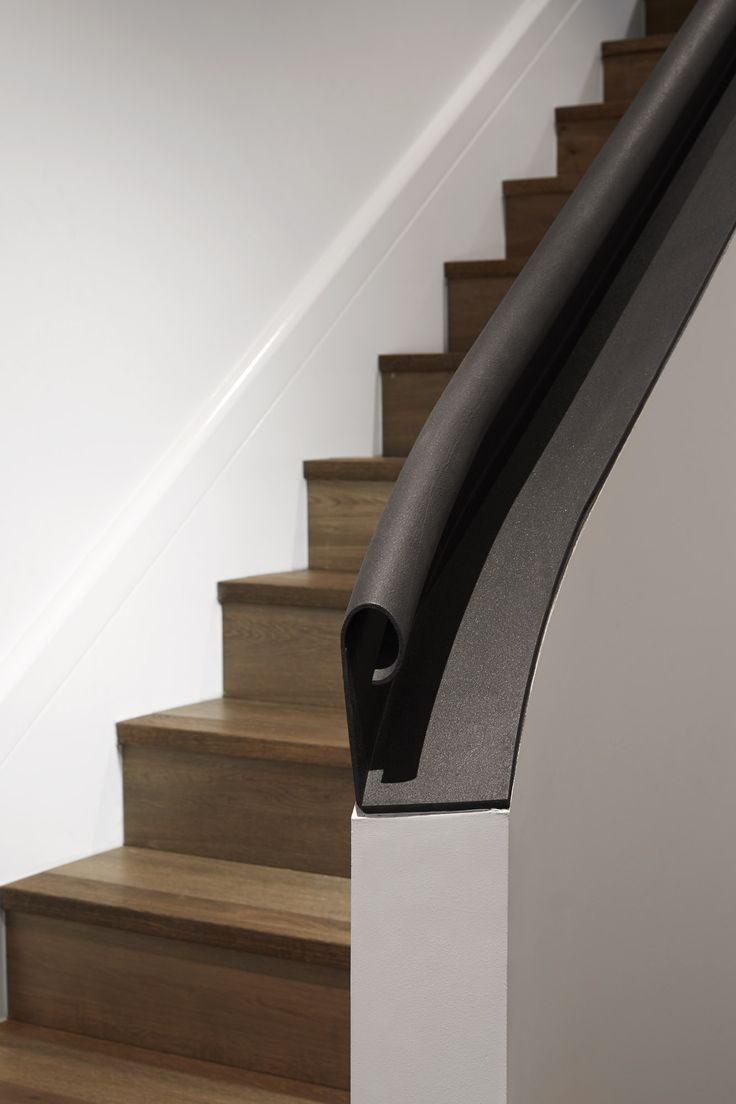 Curved handrail detail on the stairs at Canterbury Road Residence in Middle Park by B.E Architecture