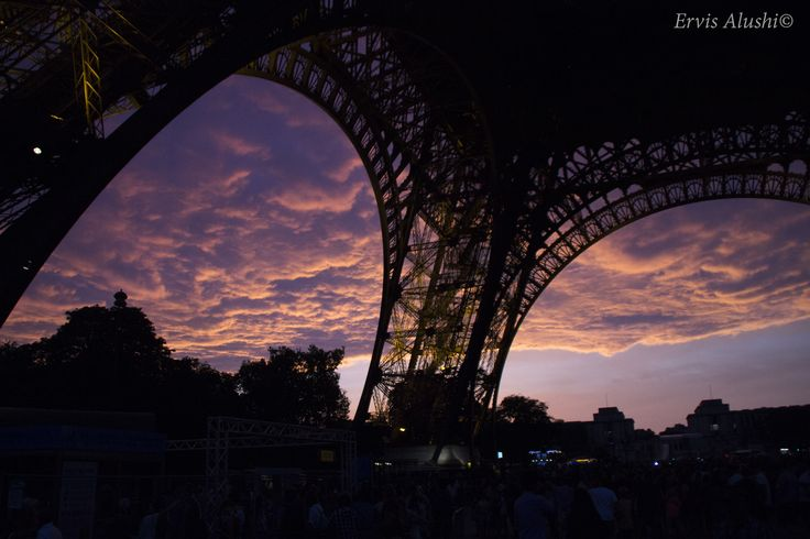 sun's going down under the tower. Paris, France