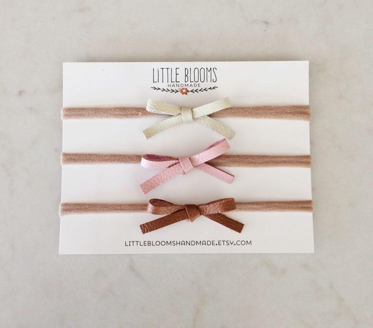 Leather Bow Headband - dainty bow on nylon headband by LittleBloomsHandmade on Etsy https://www.etsy.com/listing/236659741/leather-bow-headband-dainty-bow-on-nylon