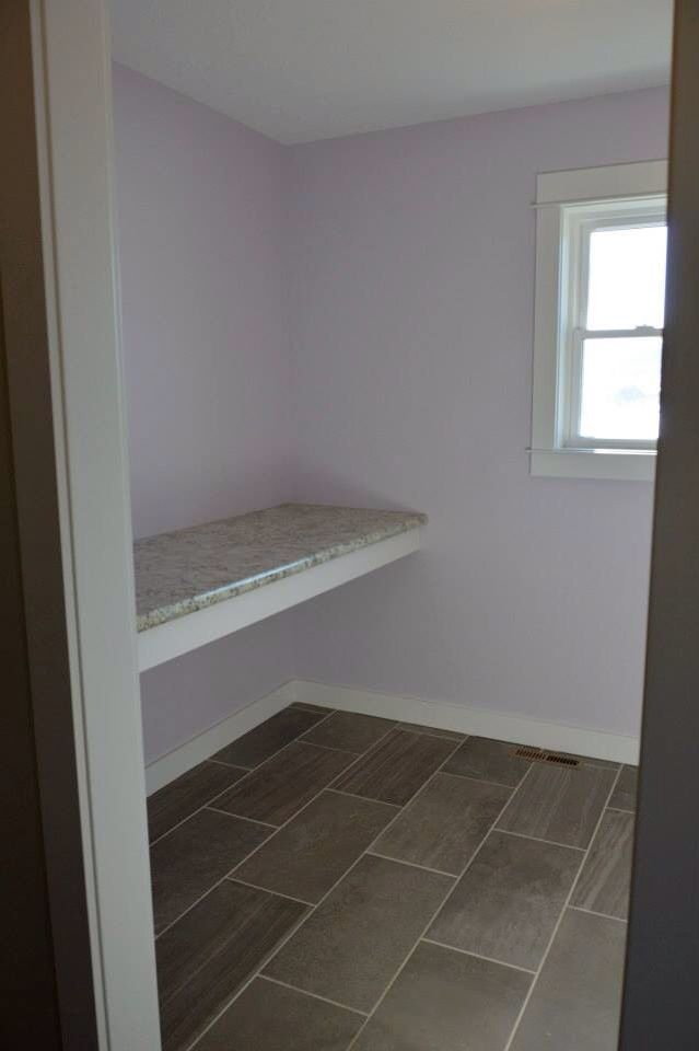 Sherwin williams silver peony light purple walls, typhoon ice wilsonart counter for folding space and storage in the laundry room