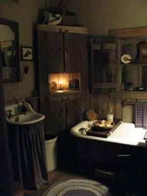 Primitive bathroom. (This decor would be so cute - on a much smaller scale - in a powder room!)  Maybe even add one of those toilets with the water tank that hangs above the toilet with the pull chain! by miriam