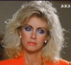 80's make up-Donna Mills style. Girl could wear some blue eyeliner,no?