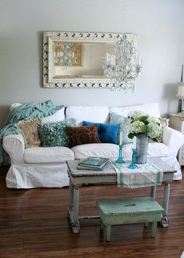 Living Room concept: light light light gray walls, colorful accent cushions, repurposed items. framed mirror to reflect light, enlarge space