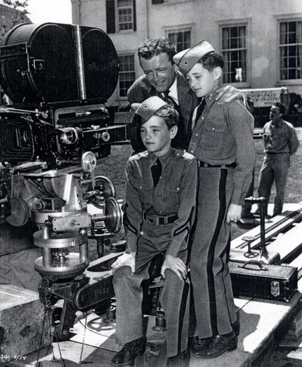 """MILITARY SCHOOL LEAVE - Robert Walker Jr. & Bobby Walker, visit their father, Robert Walker, on the set of the Paramount motion picture, """"My Son, John"""" - 1951."""